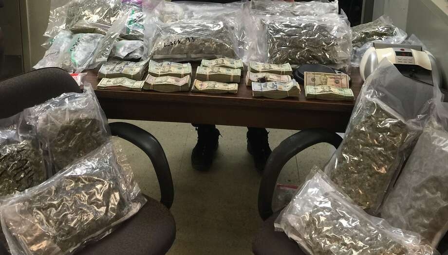 Packaged marijuana and cash sits on a table in New York after the arrest of three men on drug-related charges on Wednesday, Oct. 27, 2015. One of the men is a dentist from San Francisco who marketed his dentistry practice as marijuana-user-friendly. Photo: Courtesy, NY Special Narcotics Prosecutor