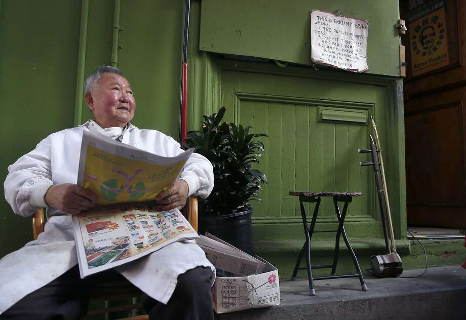"Longtime Chinatown barber Jun Yu say's he's voting for the ""bearded man."" Voters in Chinatown weigh in on the upcoming Supervisor's District 3 election between incumbent Julie Christensen and challenger Aaron Peskin in San Francisco, Calif. on Thursday, Oct. 29, 2015. Photo: Paul Chinn, The Chronicle"