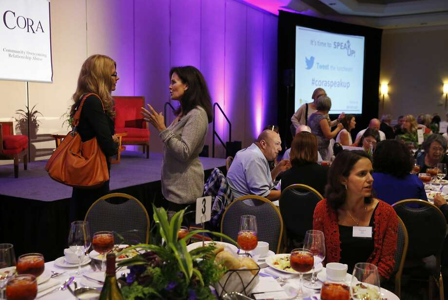 Denise Brown, right, talks with interviewer Diane Dwyer before the two took the stage during a luncheon hosted by CORA (Community Overcoming Relationship Abuse) to highlight Domestic Violence Awareness Month at the San Francisco Airport Marriott Waterfront Oct. 29, 2015 in Burlingame, Calif. Denise Brown, the sister of the late Nicole Brown Simpson, the ex-wife of professional football player O.J. Simpson, was the keynote speaker at the event. Photo: Leah Millis, The Chronicle
