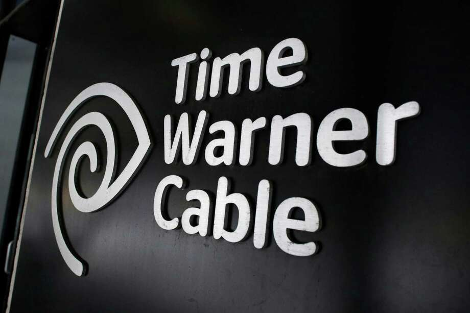 FILE - In this May 26, 2015 file photo, the Time Warner Cable corporate logo is displayed at a company store, in New York. Time Warner Cable is going to start testing in New York City a cable service that doesn't need a cable box and is delivered over their customers' home Internet. (AP Photo/Mark Lennihan, File) ORG XMIT: NYBZ175 Photo: Mark Lennihan / AP