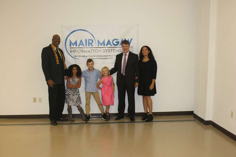 A software startup company is moving from Albany to to Amsterdam. Shown from left are Aaron Mair, co-owner of Mair Magaw Software Services, with Olivia, , Kale and Madison Magaw, company co-owner William Magaw, and Tara Magaw.