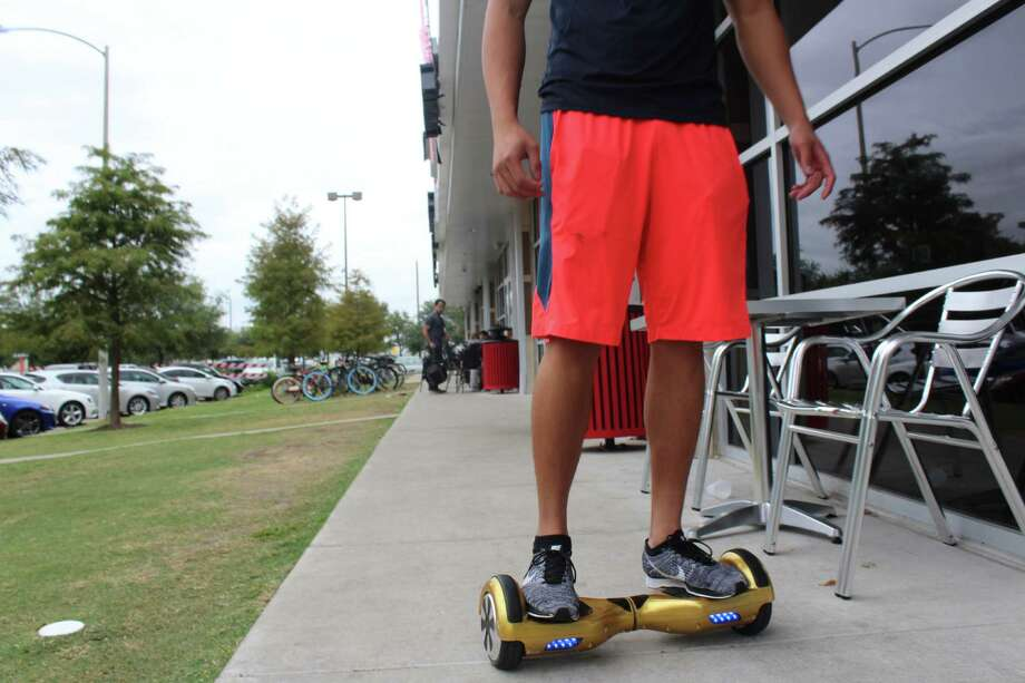"Willie Chen, 20, uses his Lyftboard to get around the University of Houston campus. ""I charge it overnight, and it lasts me around six to seven hours, so I can use it the entire day."" Photo: Sonia Zuniga"