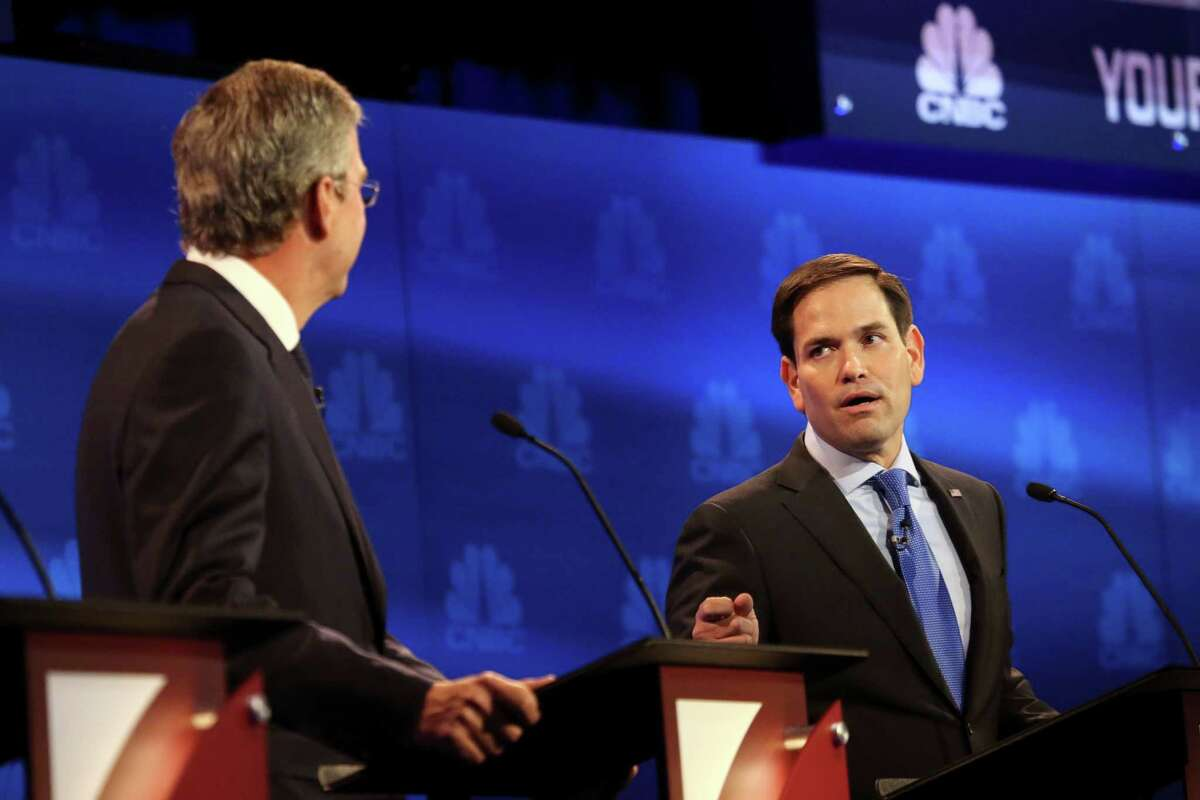 Sen. Marco Rubio spars with Jeb Bush, left, during the debate of Republican presidential hopefuls at the University of Colorado in Boulder, Oct. 28, 2015. Rubio said recent criticism of his attendance record in the Senate was off-base and an example of media bias against conservative candidates. (Jim Wilson/The New York Times)