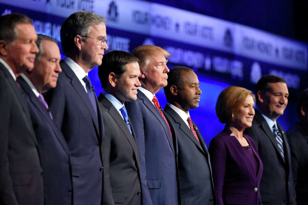 Republican presidential candidates, from left, John Kasich, Mike Huckabee, Jeb Bush, Marco Rubio, Donald Trump, Ben Carson, Carly Fiorina, and Ted Cruz take the stage during the CNBC Republican presidential debate at the University of Colorado, Wednesday, Oct. 28, 2015, in Boulder, Colo. (AP Photo/Mark J. Terrill)