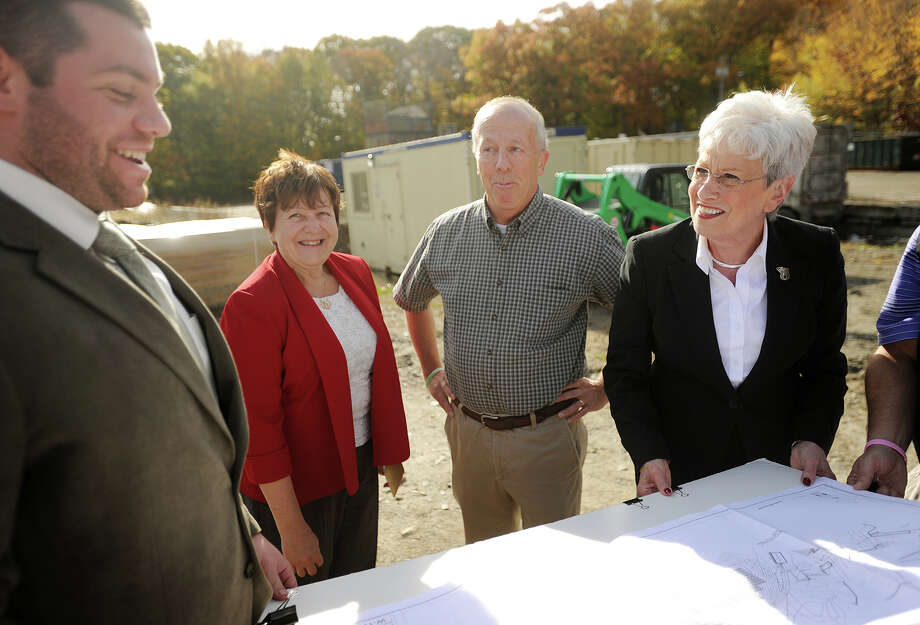 From left; BQ Energy Project Manager Mike McNulty, Derby Mayor Anita Dugatto, Derby Alderman Ron Sill, and Lieutenant Governor Nancy Wyman look at plans for the installation of nearly three thousand solar panels on the former landfill site on Pine Street in Derby, Conn. on Thursday, October 29, 2015. Photo: Brian A. Pounds / Hearst Connecticut Media / Connecticut Post