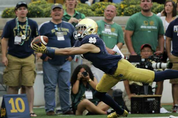 FILE - In this Sept. 26, 2015, file photo, Notre Dame's Will Fuller makes a diving grab on a pass from DeShone Kizer during the second half of an NCAA college football game against Massachusetts in South Bend, Ind. Notre Dame receiver Will Fuller can't imagine returning to his hometown Philadelphia under much better circumstances than with the ninth-ranked Fighting Irish facing undefeated and No. 19 Temple in what is being described as one of that school's most significant games ever. (AP Photo/Charles Rex Arbogast, File)