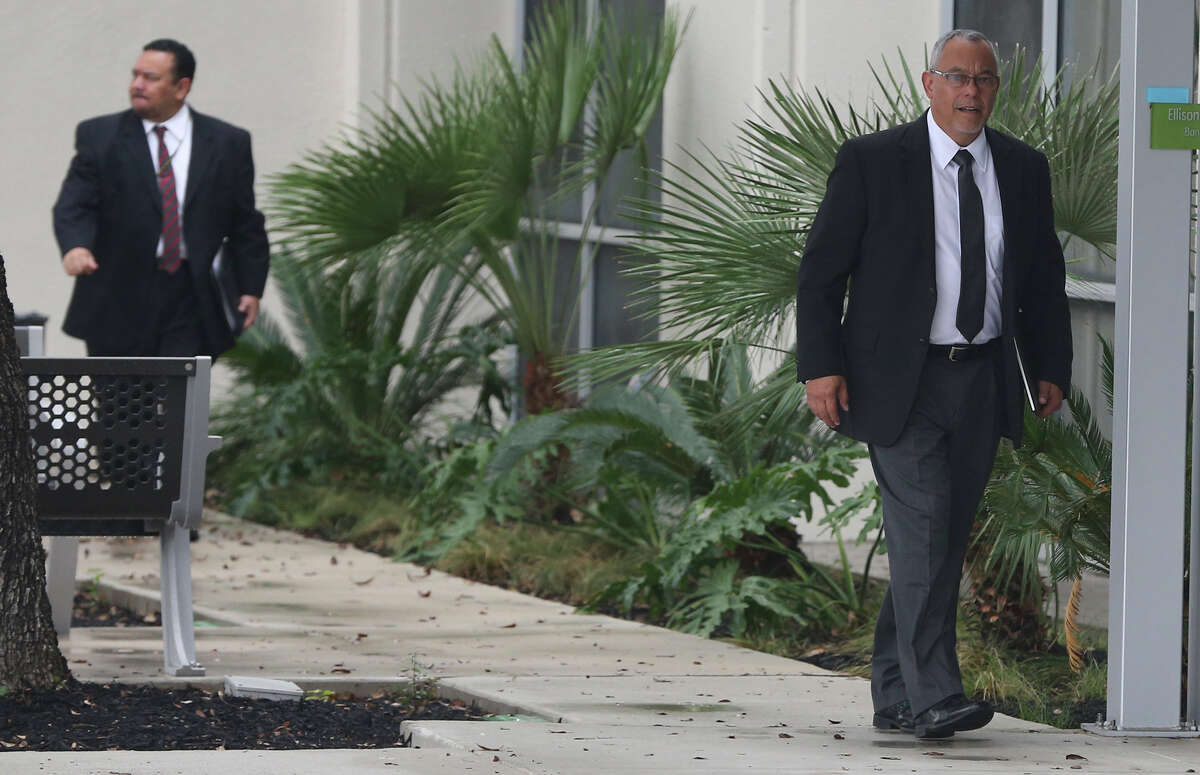 This file photo shows two men in suits entering the San Antonio Planned parenthood facility last month. Inspectors from the Health and Human Services' Office of Inspector General showed up at the San Antonio Planned Parenthood demanding thousands of pages of documents regarding patient Medicaid records.