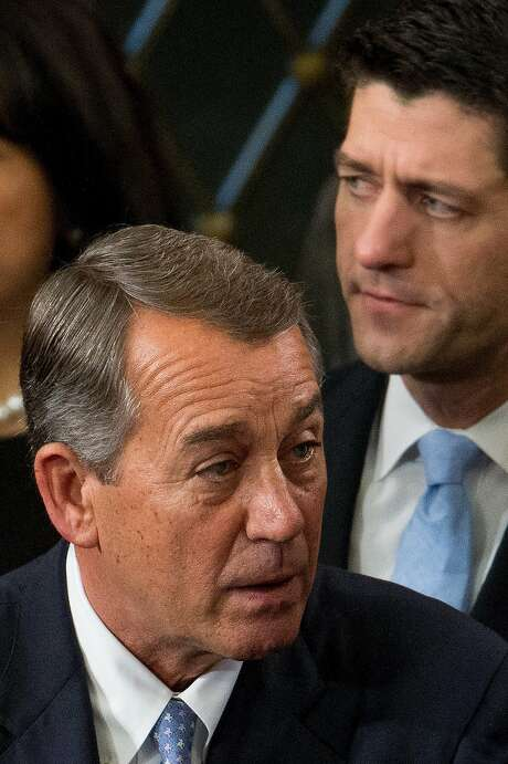 House speaker John Boehner, front, is being succeeded by Paul Ryan, back. Photo: Andrew Harnik, Associated Press
