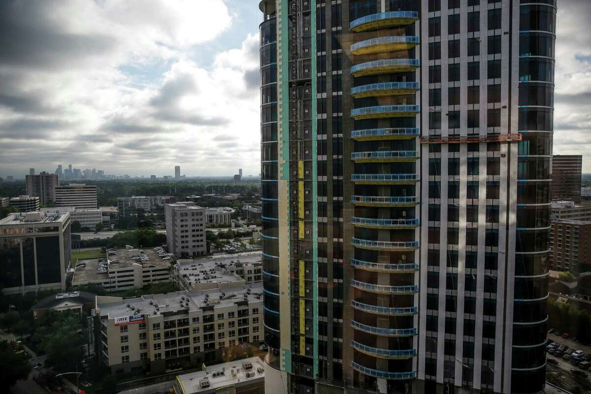 Construction crews work on the Astoria condominium building in the Galleria area Tuesday, Oct. 27, 2015, in Houston. Residential housing now surpasses retail space in terms of how land is distributed in the neighborhood. (Michael Ciaglo / Houston Chronicle)