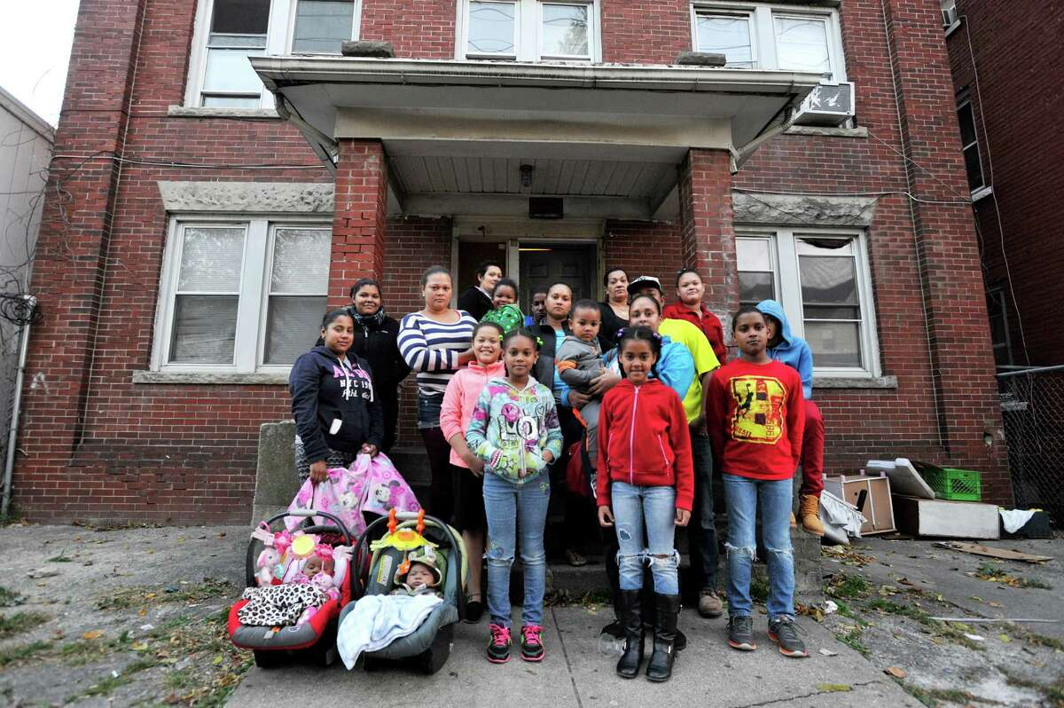 Six families were displaced last month when the back staircase of the building at 265 Greenwich Ave. broke, injuring one woman. The city shut down the building while the staircase and other repairs are being done. From left, infants Dulce Gonzalez and Jacob Rodriguez, Scarlet Garvia, Martha Herrera,Alba Cuevas, Alexa Cuevas, Dulce Rodriguez, Diana Cuevas, Ayeleen Cuevas Cordero, Brian De La Cruz, Nilka Cuevas, Yendri Cuevas Cordero, Ana Polanco, Ana Cordero, Mary Cordero, Ayennys Cuevas, Tania Cuevas, Engers De La Cruz, and Waldy Cordero are many of the displaced.