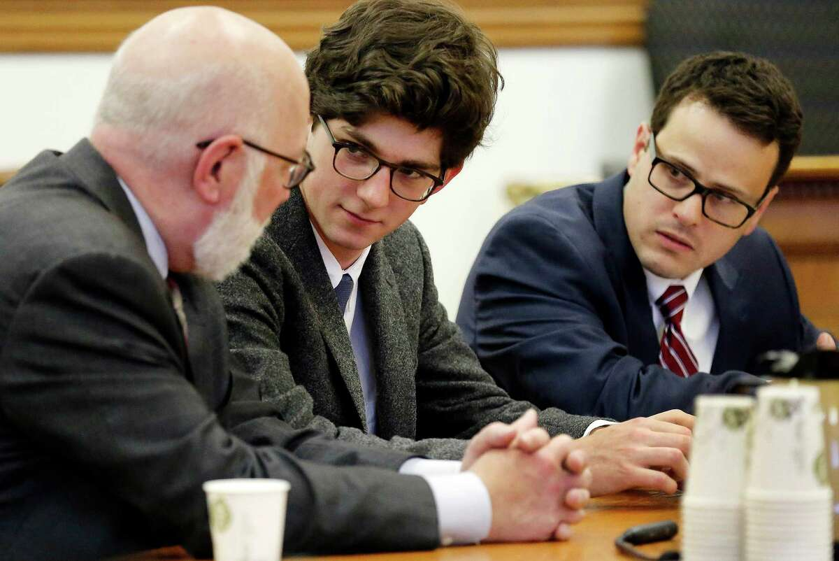 Owen Labrie, center, listens to his lawyer J.W. Carney before being sentenced in Merrimack County Superior Court Thursday Oct. 29, 2015 in Concord, N.H. The graduate of the exclusive St. Paul?'s School was sentenced to a year in jail for sexually assaulting a 15-year-old freshman girl as part of a tradition in which upperclassmen competed to rack up sexual conquests. Labrie was allowed to remain free on bail while he appeals his conviction. (AP Photo/Jim Cole, Pool)