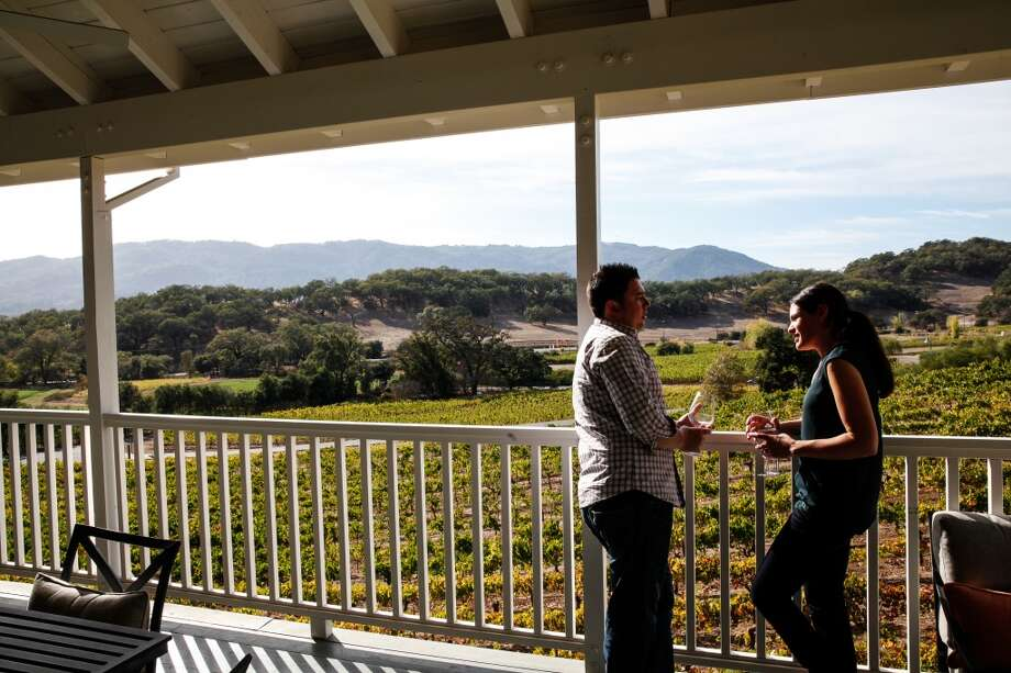 Adam and Sonia Stokes, of Chicago, drink their wine on the veranda at Arrowood Winery in Glen Ellen. Photo: Sarah Rice, Special To The Chronicle