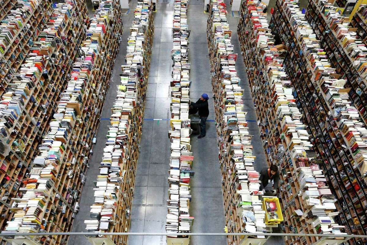 Amazon employees work  during last year's Cyber Monday. Record sales are expected this year.
