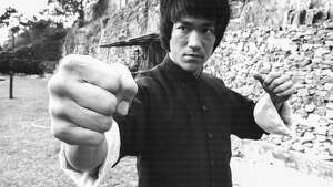 "Bruce Lee, 1940-1973. Lee is most famous for his roles in martial arts films such as ""Fist of Fury"" and ""Enter the Dragon,"" and fo developing his own style of Kung Fu, called Jeet Kune Do. He studied Wing Chun style Kung Fu under Yip Man, but later added to the style to make it more flexible. Lee's connection to the Northwest came when he studied philosophy at the University of Washington, starting in 1961, according to findagrave.com. During that time, he met future wife Linda Emery, who was from Everett. Lee died in Hong Kong under unusual circumstances with a cerberbral edema (brain swelling). He is buried at Lake View Cemetery. Photo by Stanley Bielecki Movie Collection/Getty Images."