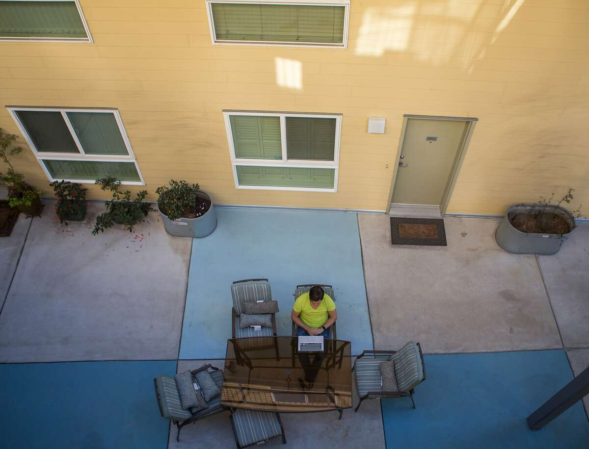 Raul Rodriguez, self-employed, works from his patio at home on Thursday, Oct. 29, 2015 in Oakland, Calif.