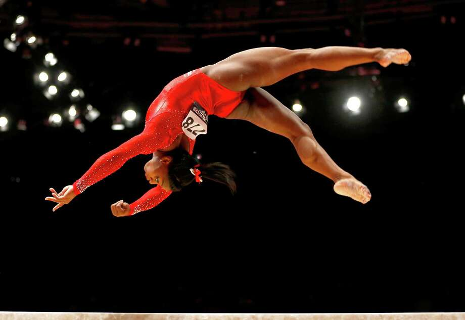 Spring's Simone Biles had all the right moves on the balance beam Thursday on the way to her third world title. Photo: Matthias Schrader, STF / AP