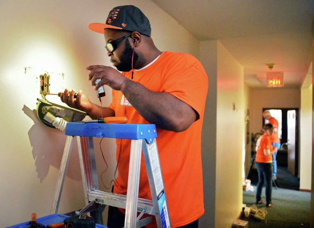 Home Depot Sales Specialist Marcus Brooks Replaces A Light Fixture As More Than 25