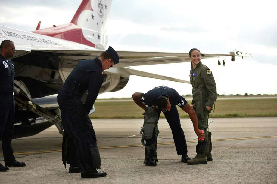 "San Antonio Spurs assistant coach Becky Hammon prepares for her flight in an Air Force Thunderbirds aerobatic demonstration team F-16 jet at JBSA-Randolph on Thursday, Oc. 29, 2015. The 2015 Joint Base San Antonio Air Show and Open House is slated for this weekend. It will be the first air show in San Antonio since 2011. After the flight, Hammon commented, ""God's handiwork is always the prettiest, and up there, it's hard to put into words."" Hammon's boss with the Spurs, head coach Gregg Popovich, encouraged her to take the flight. Photo: Billy Calzada, San Antonio Express-News / San Antonio Express-News"
