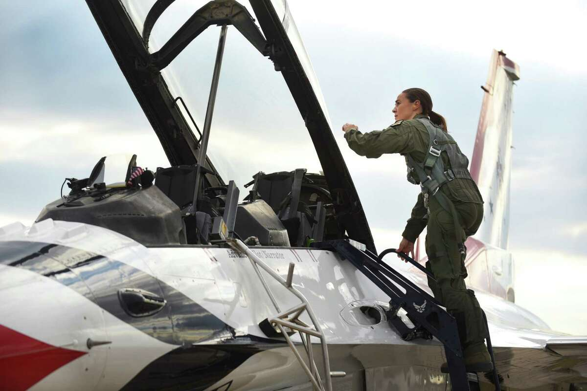 San Antonio Spurs assistant coach Becky Hammon climbs a ladder into an Air Force Thunderbirds aerobatic demonstration team F-16 jet for a flight at JBSA-Randolph on Thursday, Oc. 29, 2015. The 2015 Joint Base San Antonio Air Show and Open House is slated for this weekend. It will be the first air show in San Antonio since 2011. After the flight, Hammon commented,