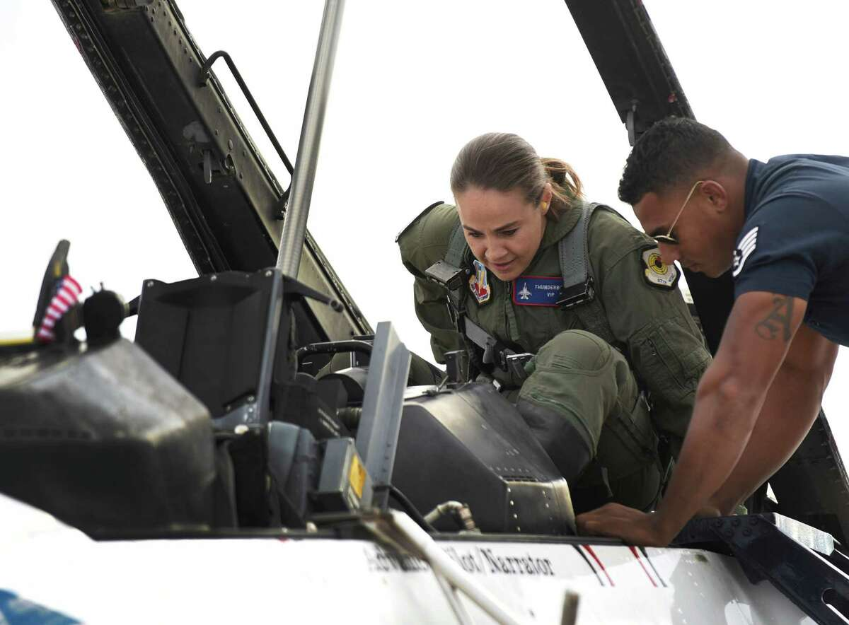 San Antonio Spurs assistant coach Becky Hammon straps into an Air Force Thunderbirds aerobatic demonstration team F-16 jet for a flight at JBSA-Randolph on Thursday, Oc. 29, 2015. The 2015 Joint Base San Antonio Air Show and Open House is slated for this weekend. It will be the first air show in San Antonio since 2011. After the flight, Hammon commented,