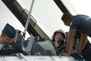"San Antonio Spurs assistant coach Becky Hammon reacts after the canopy is opened at the end of her demonstration flight in a Thunderbirds F-16 jet at JBSA-Randolph on Thursday, Oc. 29, 2015. The 2015 Joint Base San Antonio Air Show and Open House is slated for this weekend. It will be the first air show in San Antonio since 2011. After the flight, Hammon commented, ""God's handiwork is always the prettiest, and up there, it's hard to put into words."" Hammon's boss with the Spurs, head coach Gregg Popovich, encouraged herto take the flight."