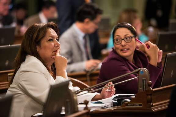 Assemblywoman Patty Lopez, left, with Assemblywoman Cristina Garcia. Assemblymembers Patty López (D-Arleta), left, and Cristina Garcia (D-Downey) in the Assembly chambers, September 10, 2015 at the State Capitol in Sacramento, California.
