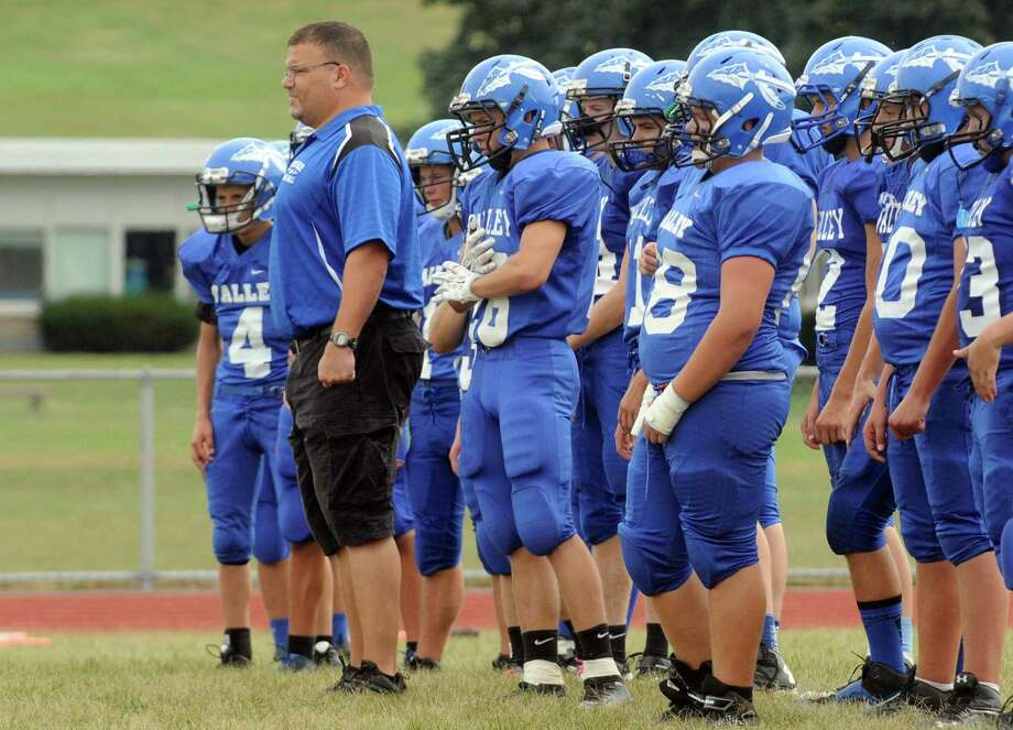 Head coach Pete Porcelli of the Hoosic Valley High School football team warms up his team before their game against Corinth on Saturday Sept. 12, 2015 in Schaghticoke, N.Y.  (Michael P. Farrell/Times Union) Photo: Michael P. Farrell / 00033304B