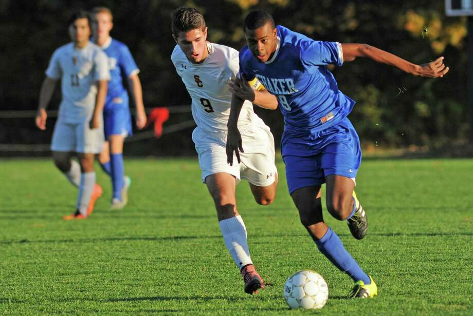Shaker's Matthew JeanPierre brings the ball up field defended by Colonie's Arron Muia during their Section II Class AA boys' high school soccer semifinal on Thursday Oct. 28, 2015 in Colonie, N.Y. (Michael P. Farrell/Times Union) Photo: Michael P. Farrell / 00033978A