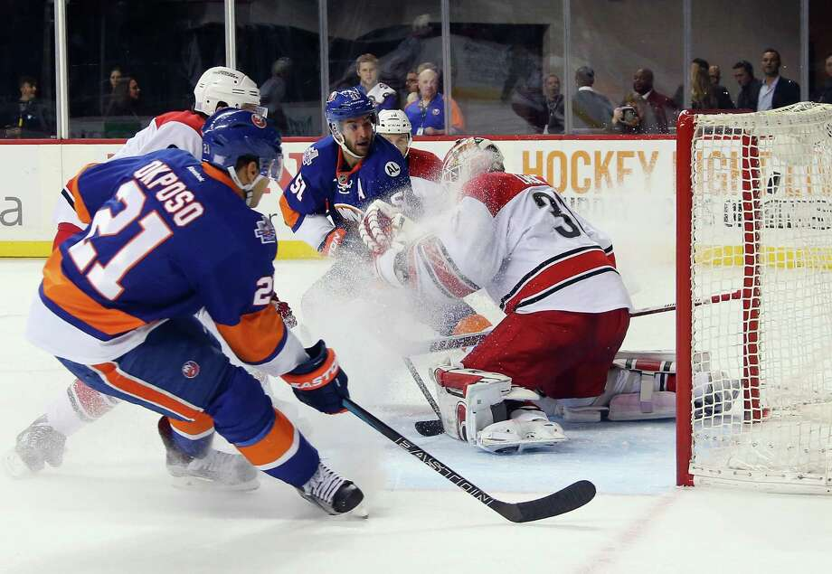 NEW YORK, NY - OCTOBER 29:  Frans Nielsen #51 of the New York Islanders scores a powerplay goal at 12:50 of the second period against Eddie Lack #31 of the Carolina Hurricanes at the Barclays Center on October 29, 2015 in the Brooklyn borough of New York City.  (Photo by Bruce Bennett/Getty Images) ORG XMIT: 574712103 Photo: Bruce Bennett / 2015 Getty Images