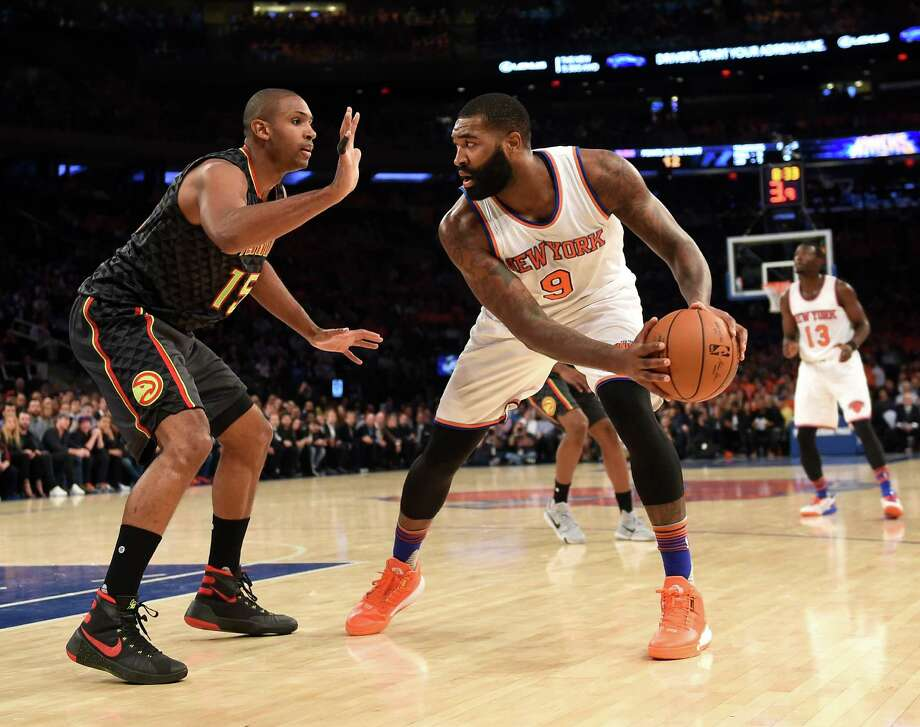 New York Knicks forward Kyle O'Quinn (9) tries to move the ball around Atlanta Hawks forward Al Horford (15) during the first half of an NBA basketball game on Thursday, Oct. 29, 2015, in New York. (AP Photo/Kathy Kmonicek)  ORG XMIT: MSG106 Photo: Kathy Kmonicek / FR170189 AP