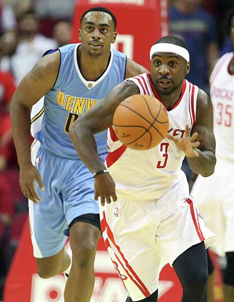 Rockets new point guard Ty Lawson struggled to find his shot in the season-opening loss the Nuggets on Wednesday, shooting 3-for-10 from the floor. Photo: James Nielsen, Staff / © 2015  Houston Chronicle