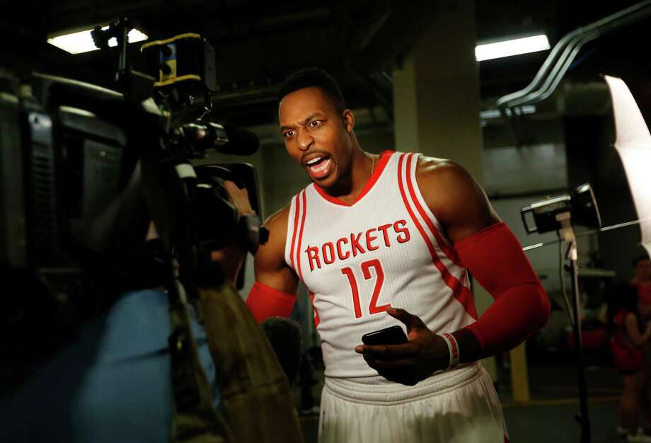 The Rockets expect to receive a steady source of energy from center Dwight Howard as he makes his regular-season debut Friday against the Warriors. Photo: Mark Mulligan, Staff / © 2015 Houston Chronicle