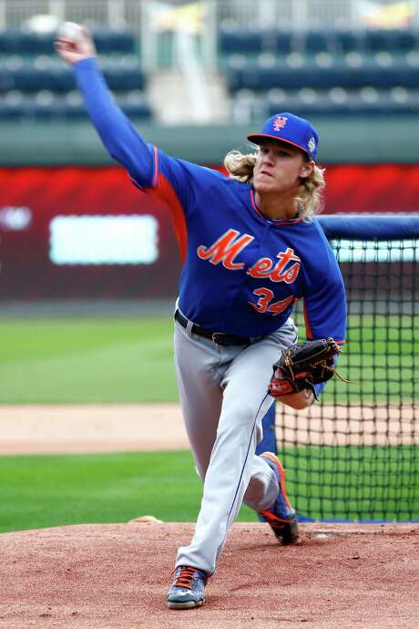 Mets starter Noah Syndergaard was 9-7 with a 3.24 ERA and 166 strikeouts during the regular season. He's 1-1 with a 2.77 ERA in three playoff outings. Photo: Maxx Wolfson, Staff / 2015 Getty Images