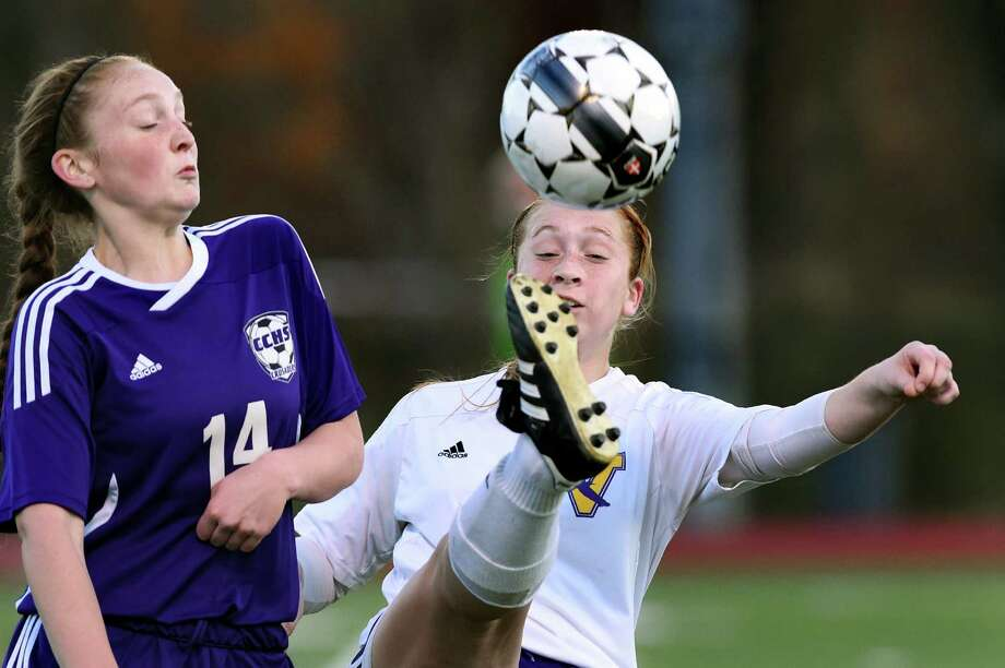 Voorheesville's Julia Voss, right, boots the ball as Catholic Central's Emily Frodyma defends during their Class B soccer semifinal on Thursday, Oct. 29, 2015, at Stillwater High in Stillwater, N.Y. Clair scored both goals. (Cindy Schultz / Times Union) Photo: Cindy Schultz / 00033990A
