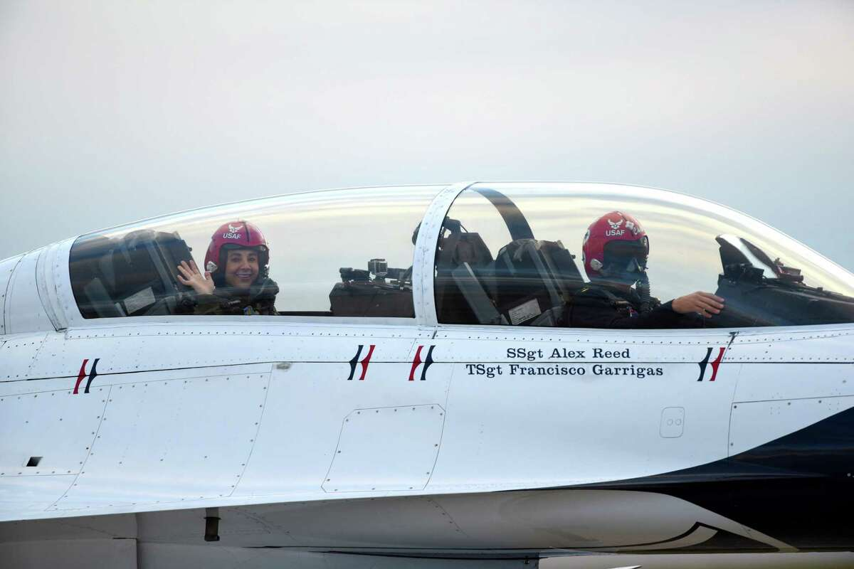 San Antonio Spurs assistant coach Becky Hammon waves Thursday after a flight in a U.S. Air Force Thunderbirds F-16 jet at Joint Base San Antonio-Randolph. Hammon's boss, Spurs head coach Gregg Popovich, encouraged her to take the flight.