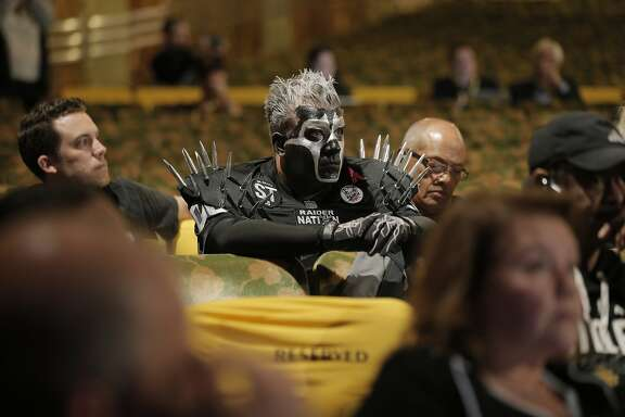 Oakland Raiders fan Joey Seimas from Fresno listens to fans' comments as members of NFL Commissioner Roger GoodellÕs staff held a public hearing on the idea of the Raiders football team moving to southern California at the Paramount Theater in Oakland, Calif., on Thursday, October 29, 2015.