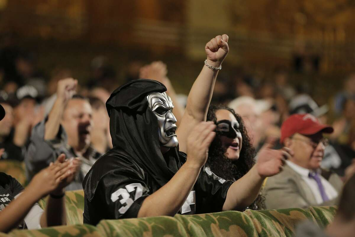 Oakland Raiders fans cheer comments from Mayor Libby Schaaf as members of NFL Commissioner Roger Goodell?•s staff held a public hearing on the idea of the Raiders football team moving to southern California at the Paramount Theater in Oakland, Calif., on Thursday, October 29, 2015.