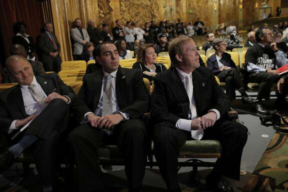 L-R, Raiders President Marc Badain, Executive Vice President Dan Ventrelle, and Owner Mark Davis listen to fan comments as members of NFL Commissioner Roger GoodellÕs staff held a public hearing on the idea of the Raiders football team moving to southern California at the Paramount Theater in Oakland, Calif., on Thursday, October 29, 2015.