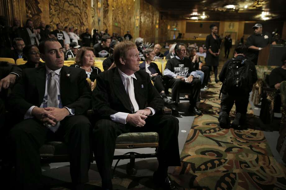 Oakland Raiders Owner Mark Davis, center, and Executive Vice President General Counsel, Dan Ventrelle, left, listen to fan comments as members of NFL Commissioner Roger GoodellÕs staff held a public hearing on the idea of the Raiders football team moving to southern California at the Paramount Theater in Oakland, Calif., on Thursday, October 29, 2015. Photo: Carlos Avila Gonzalez, The Chronicle