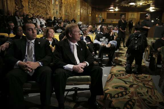 Oakland Raiders Owner Mark Davis, center, and Executive Vice President General Counsel, Dan Ventrelle, left, listen to fan comments as members of NFL Commissioner Roger GoodellÕs staff held a public hearing on the idea of the Raiders football team moving to southern California at the Paramount Theater in Oakland, Calif., on Thursday, October 29, 2015.