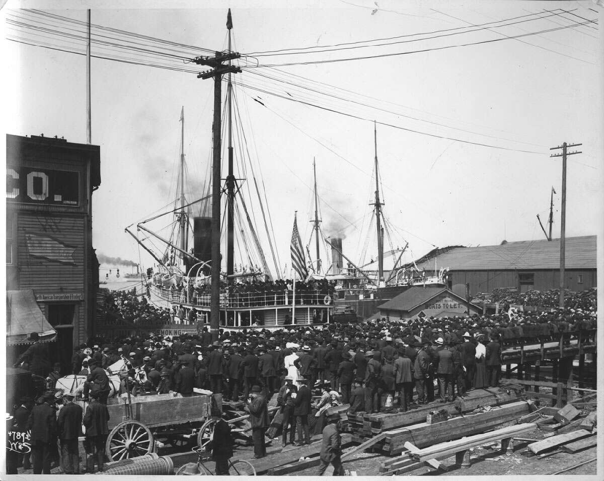 A crowd gathers at the Seattle waterfront for Alaska during gold rush in 1898. Seattle Muncipal Archive photo.