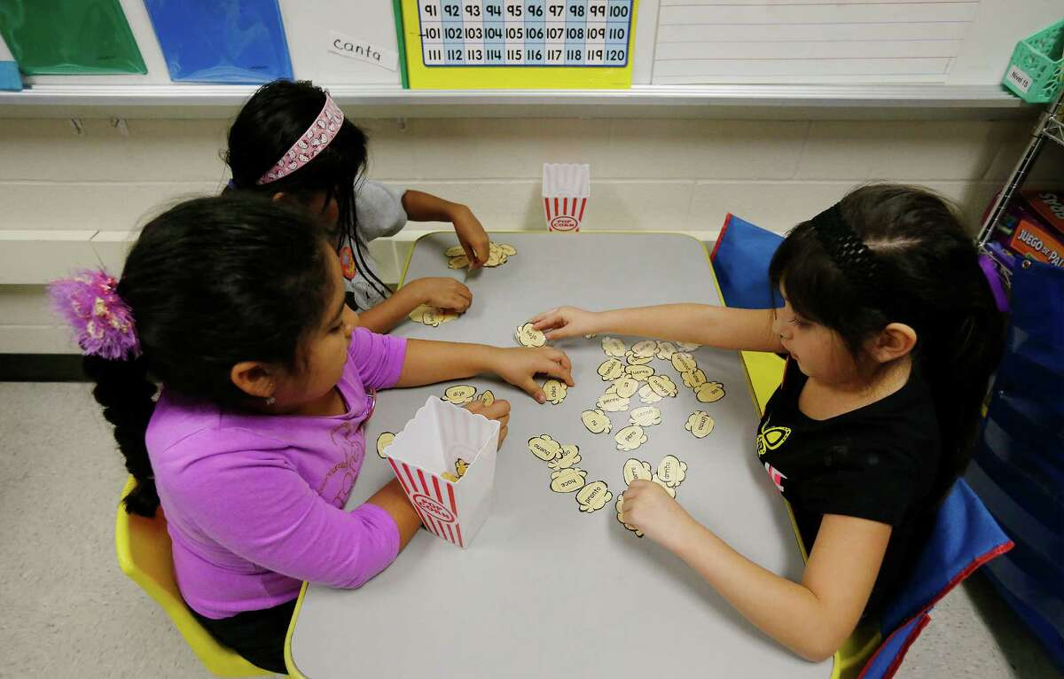 First-grade students in Mary Helen Romero's class attempt to recognize Spanish words written on tiles in their dual language class where a major portion of their lessons are taught in Spanish and the rest in English at Adams Elementary on Wednesday, Oct. 28, 2015. This approach has garnered Harland Independent School District recognition for their dual language strategies by the New American Foundation. Both English and Spanish-dominant language students are enrolled in Mrs. Romero's class. (Kin Man Hui/San Antonio Express-News)