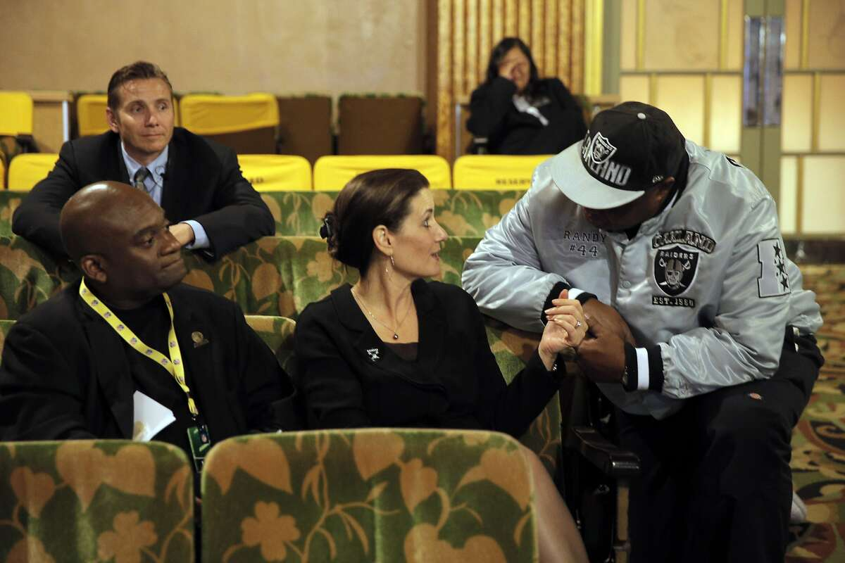 Oakland Raiders fan Randy Wright from Benicia speaks with Oakland Mayor Libby Schaaf as members of NFL Commissioner Roger Goodell's staff held a public hearing on the idea of the Raiders football team moving to southern California at the Paramount Theater in Oakland, Calif., on Thursday, October 29, 2015.