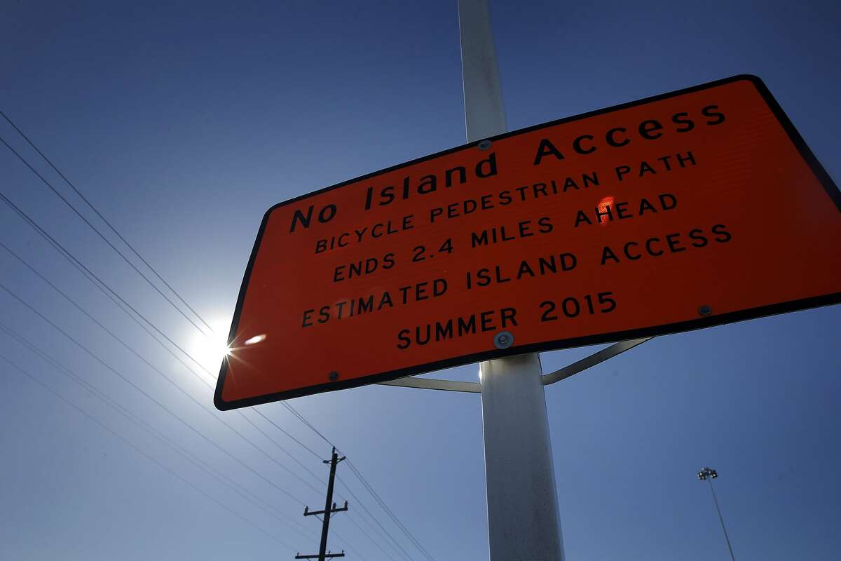 A Caltrans sign shows the previously-expected opening date of the Pedestrian and Bicycle Path on the Bay Bridge in Oakland, Calif., on Thursday, October 29, 2015.
