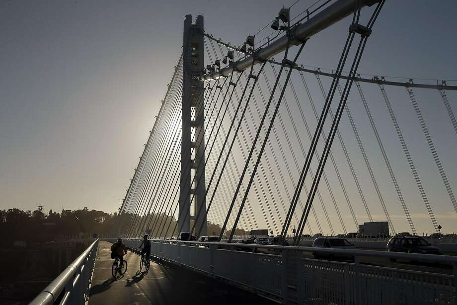 Bicycles make thier way up the Bicycle Pedestrian Path on the Bay Bridge in Oakland, Calif., on Thursday, October 29, 2015. The Bay Bridge bike path from Oakland to Treasure Island has been delayed yet again. Originally scheduled to open along with the new eastern span two years ago, completion had to wait for demolition of part of the old span, which was to be completed by summer. Then it was delayed until late fall/end of the year. Now, it looks like bike riders won't be able to pedal from the East Bay to Treasure Island until sometime next year. Photo: Carlos Avila Gonzalez, The Chronicle