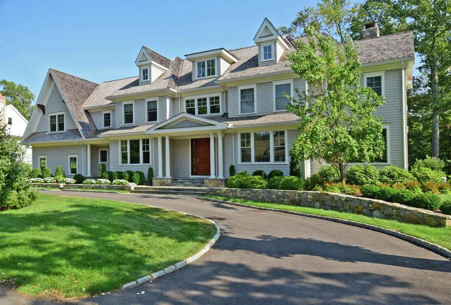 The property at 7 Pumpkin Hill Road is on the market for $2,999,000. The 7,055 square-foot Colonial was built in 2013. Photo: Contributed / Contributed Photo / Westport News