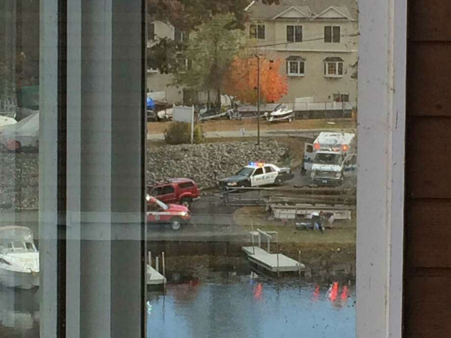 Police and EMT respond to an accident on Candlewood Lake when a pontoon boat flips and pins a man Thursday. Photo: / Contributed Photo / Scott Brydson