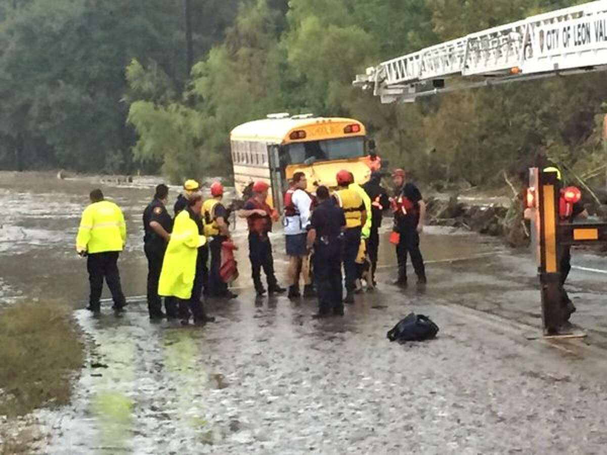 Bexar County Sheriff's Department tweeted out a photo and said a total of 4 special needs students and 2 adults rescued from flooded bus on Scenic Loop.