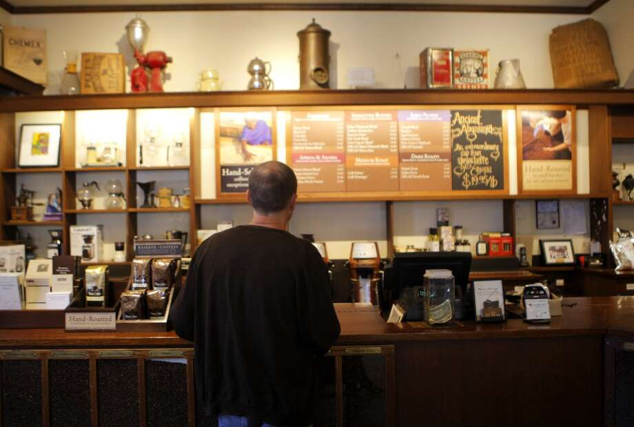 CLICK THE GALLERY FOR SMALL WAYS TO BRIGHTEN SOMEONE'S DAY TODAY Buy someone a cup of coffee. It's a simple way to pay it forward—literally! And there's no telling how far the gesture can go. Photo: Megan Farmer, The Chronicle