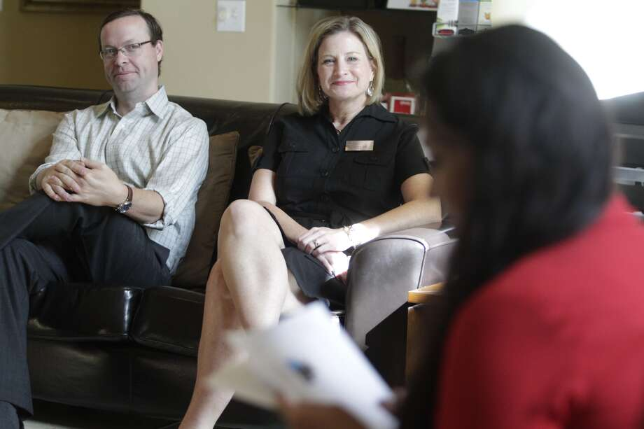 "Venterra Realty Director of Property Management Bryan George and Senior Regional Manager Lissa May listen to apartment manager Adriana Reagan during a weekly ""huddle"" employees meeting at the Silverbrooke Apartments. (J. Patric Schneider/For the Chronicle)"